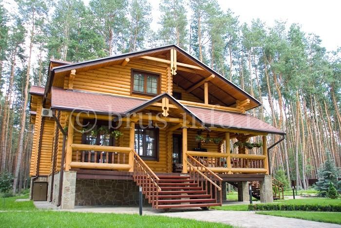 Двухэтажный дом из оцилиндрованного бревна