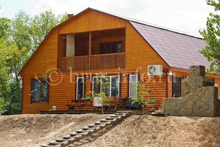 Деревянный дом с обшивкой блок хаусом