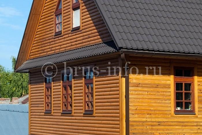 Деревянный дом, облицованный блок хаусом